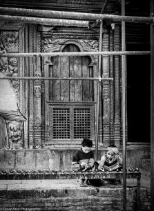 Lighting the candles at the Bagalamukhi Temple in Patan