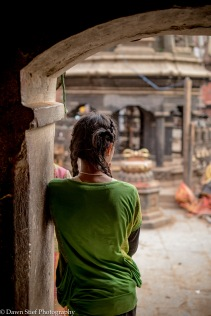 Girl at the entry of the temple